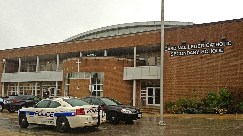 Peel Regional Police investigate after someone was stabbed at Brampton's Cardinal Leger Secondary School on Tuesday, Sept. 4, 2012. (Tom Stefanac / CTV Toronto)