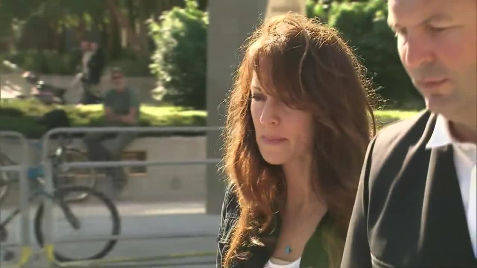 Mary Gowans leaves a Toronto courtroom on Wednesday, Sept. 12, 2012.