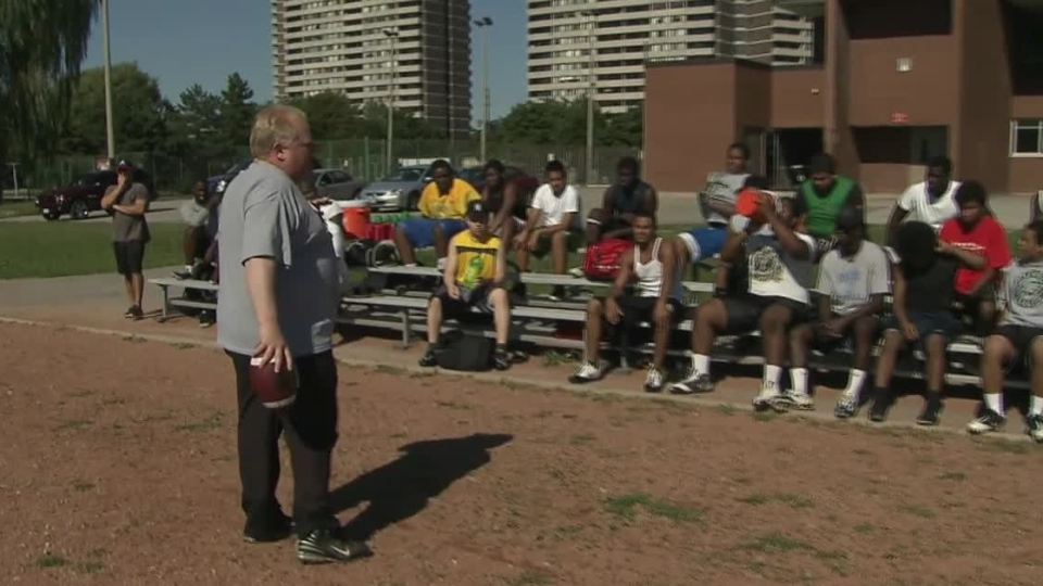 Toronto Mayor Rob Ford coaches football on Tuesday, Sept. 11, 2012.