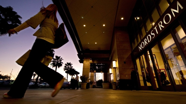A customer walks out of a Nordstrom store in Los Angeles on Feb. 11, 2011.