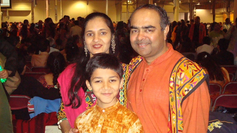 In this undated photo Jayesh Prajapati is seen with his wife and son. Prajapati died in Toronto after trying to stop a driver from fleeing from a gas station with stolen gas on Sept. 15, 2012. (Photo courtesy: Prajapati family friend)