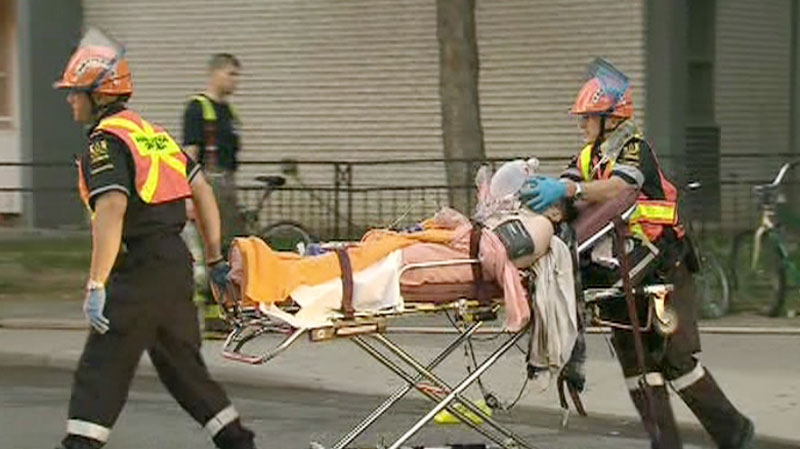 Paramedics take a patient to an ambulance at the Wellesley St. fire on Friday, Sept. 24, 2010.