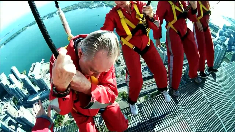 Michael Welch walks the edge of Toronto's CN Tower in Toronto on Oct. 8, 2012. (CTV News)