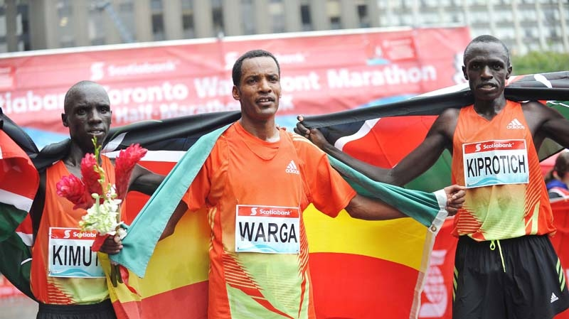 Ethiopia's Sahle Warga (centre) finishes first at the Scotiabank Toronto Waterfront Marathon (2:10:35) on Sunday, Oct.14, 2012, followed by Kenyan runners Kiplimo Kimutai (2:11:20) and John Kiprotich (2:11:29). (Ho / THE CANADIAN PRESS)