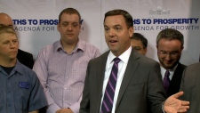 Opposition Leader Tim Hudak speaks to the press
